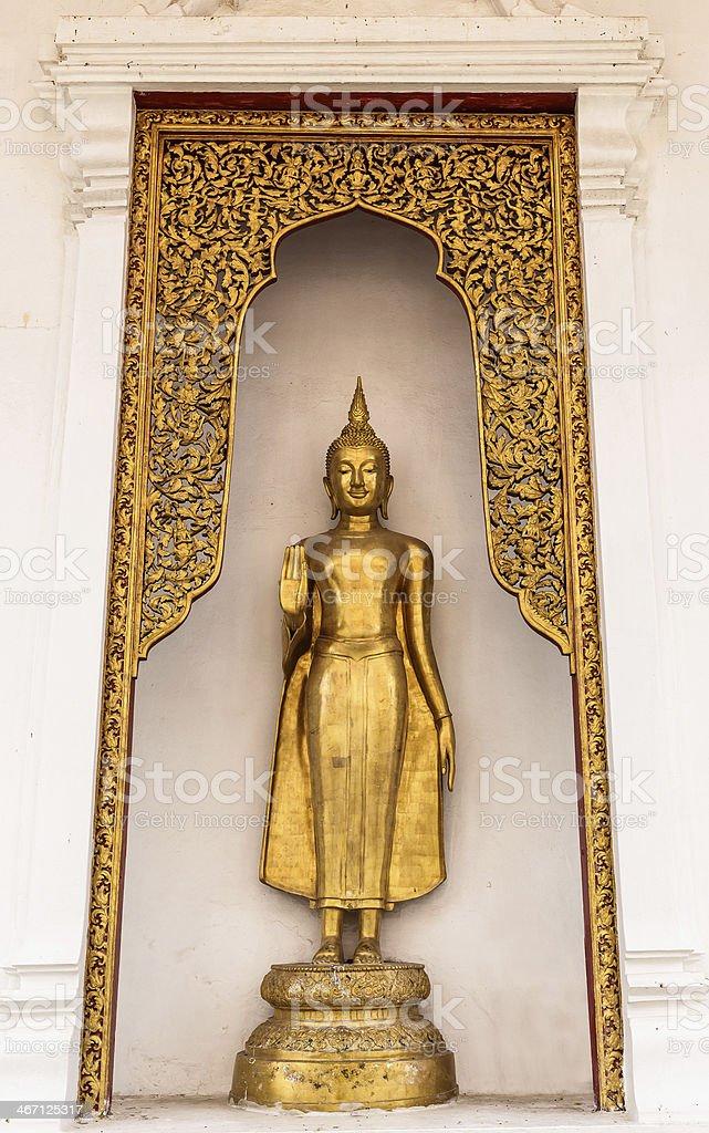 Yellow Buddha statue stock photo