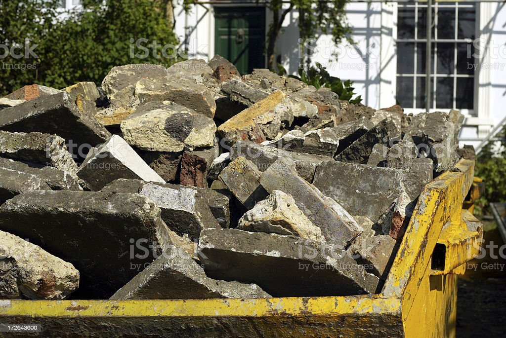 Yellow Builders Rubbish Skip royalty-free stock photo