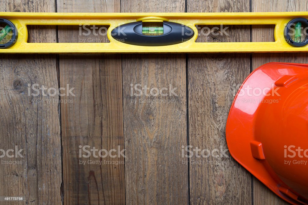 Yellow building level and red helmet stock photo