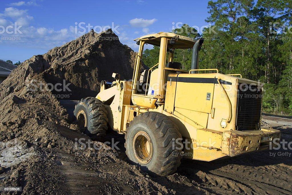 Yellow Bulldozer At Job Site stock photo