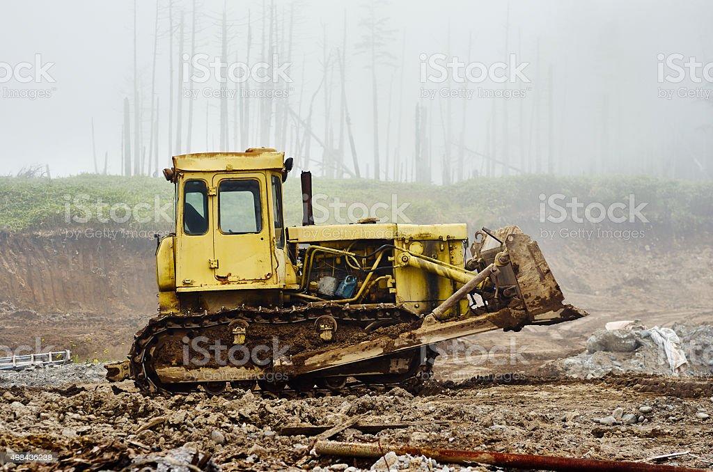 Yellow bulldozer digging stock photo