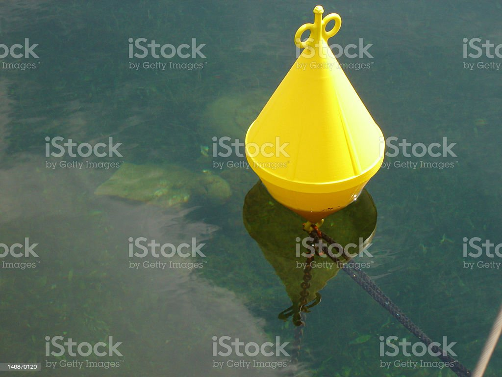 Yellow Buoy in calm weather royalty-free stock photo