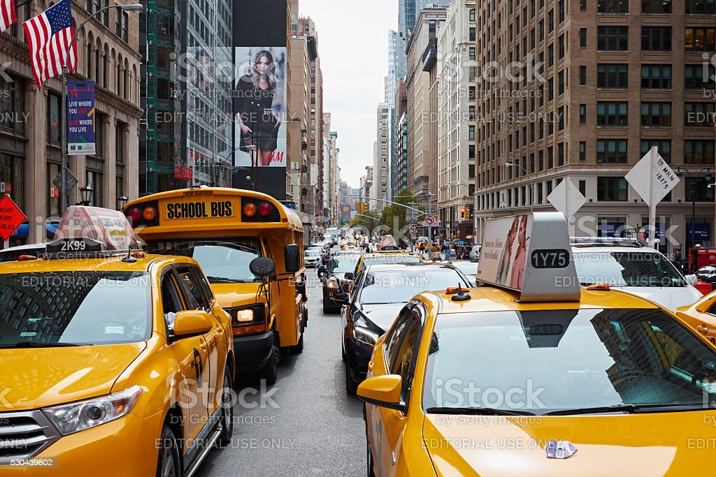 yellow cab and school bus nyc stock photo