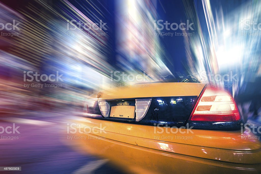 Yellow cab at rush hour in Times Square royalty-free stock photo