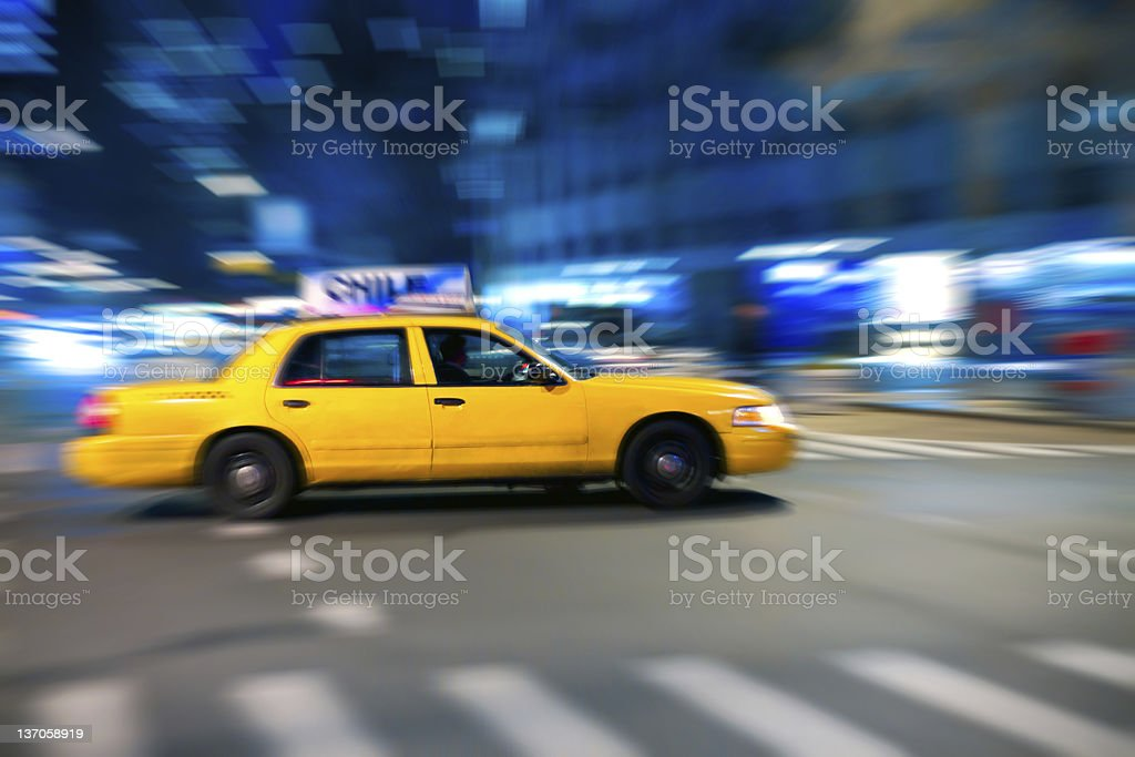 Yellow cab at the crossroads with zoom effect. stock photo