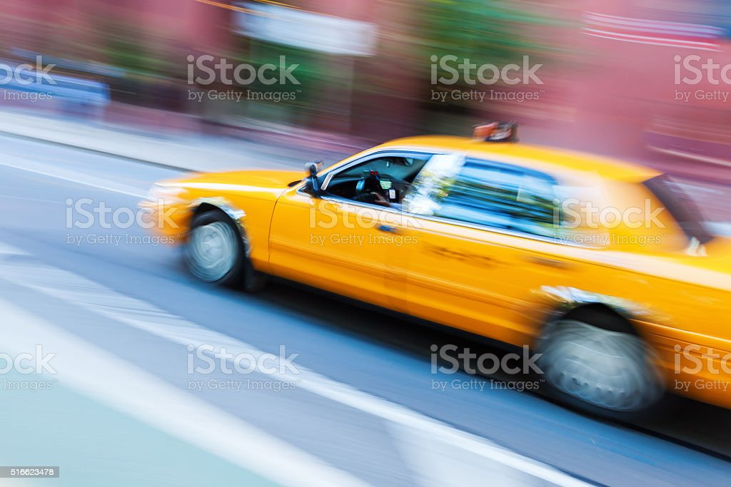 yellow cab from New York City in motion blur stock photo