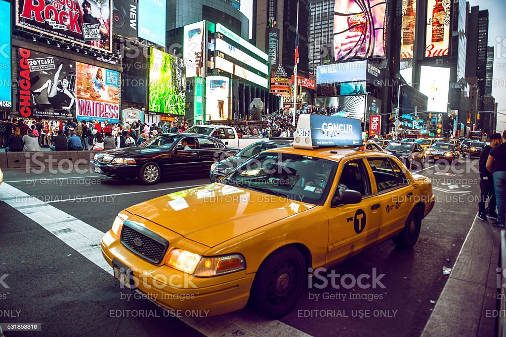 Yellow cab on Times Square traffic in New York City stock photo