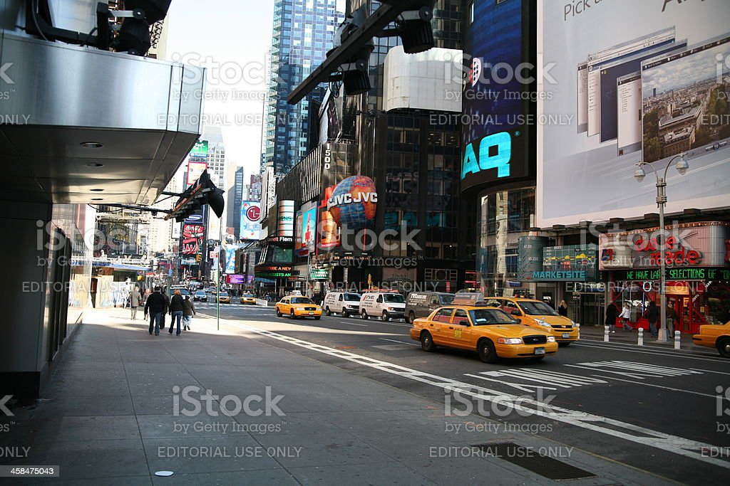 NYC yellow cabs pass Times Square royalty-free stock photo