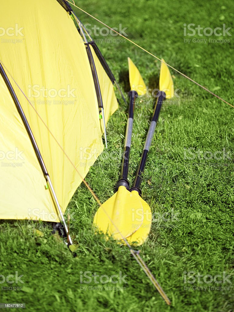 Yellow Camping Tent And Kayak Paddles royalty-free stock photo