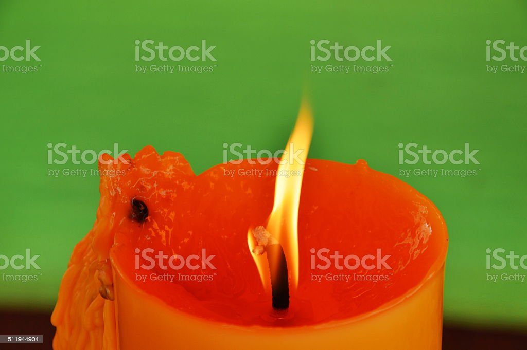 yellow candle worship burning in temple stock photo