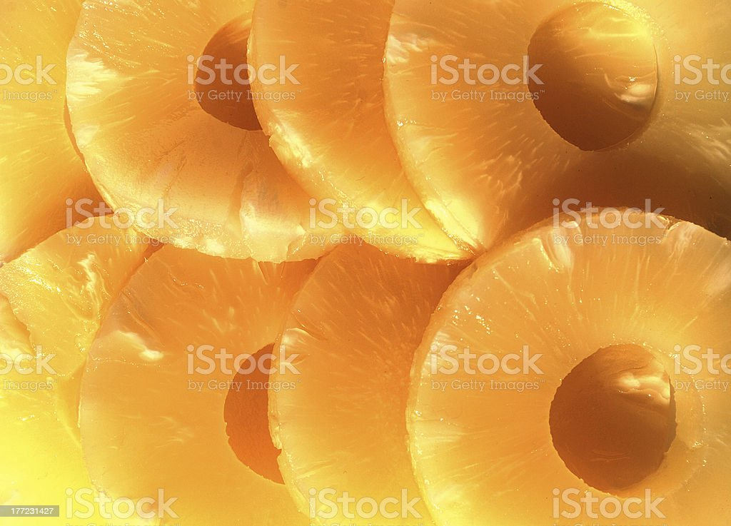 yellow canned pineapple rings, vegetarian food stock photo