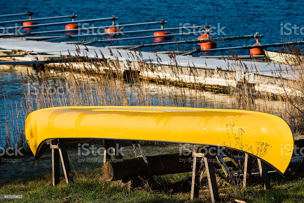 Yellow canoe on land stock photo