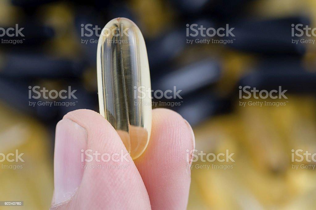Yellow capsule royalty-free stock photo