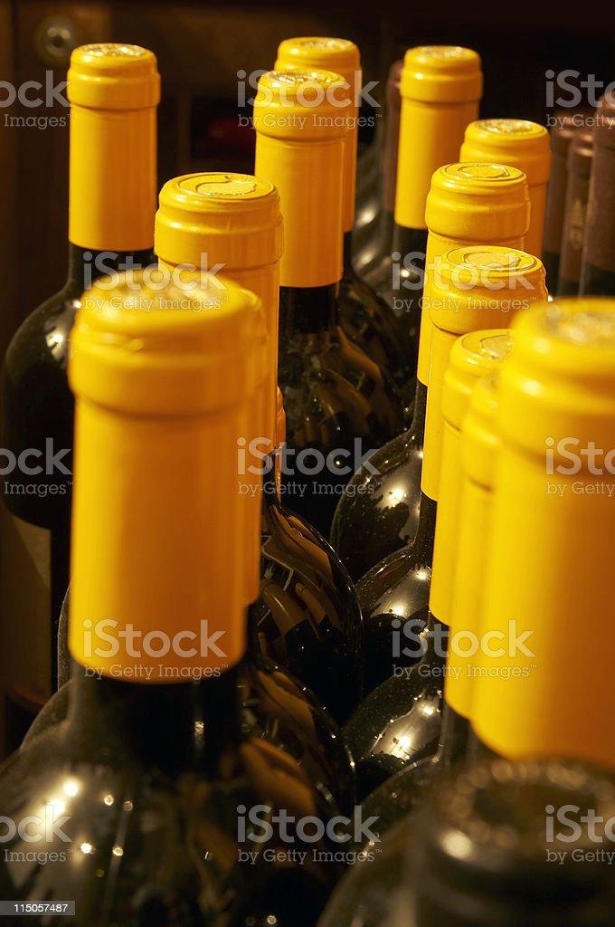 Yellow capsuled bottle necks royalty-free stock photo