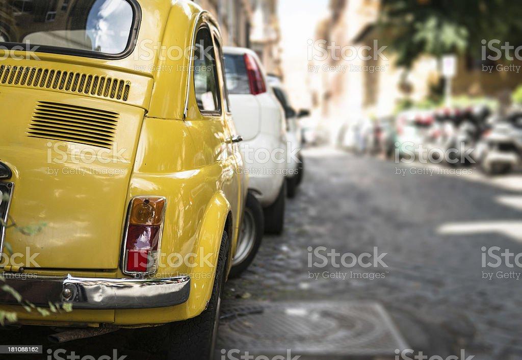 yellow car in italian street stock photo
