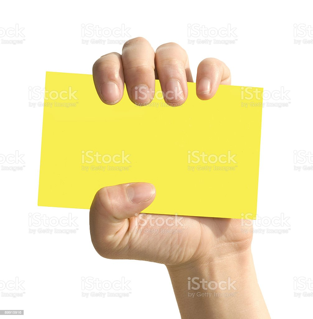 yellow card in woman hand royalty-free stock photo