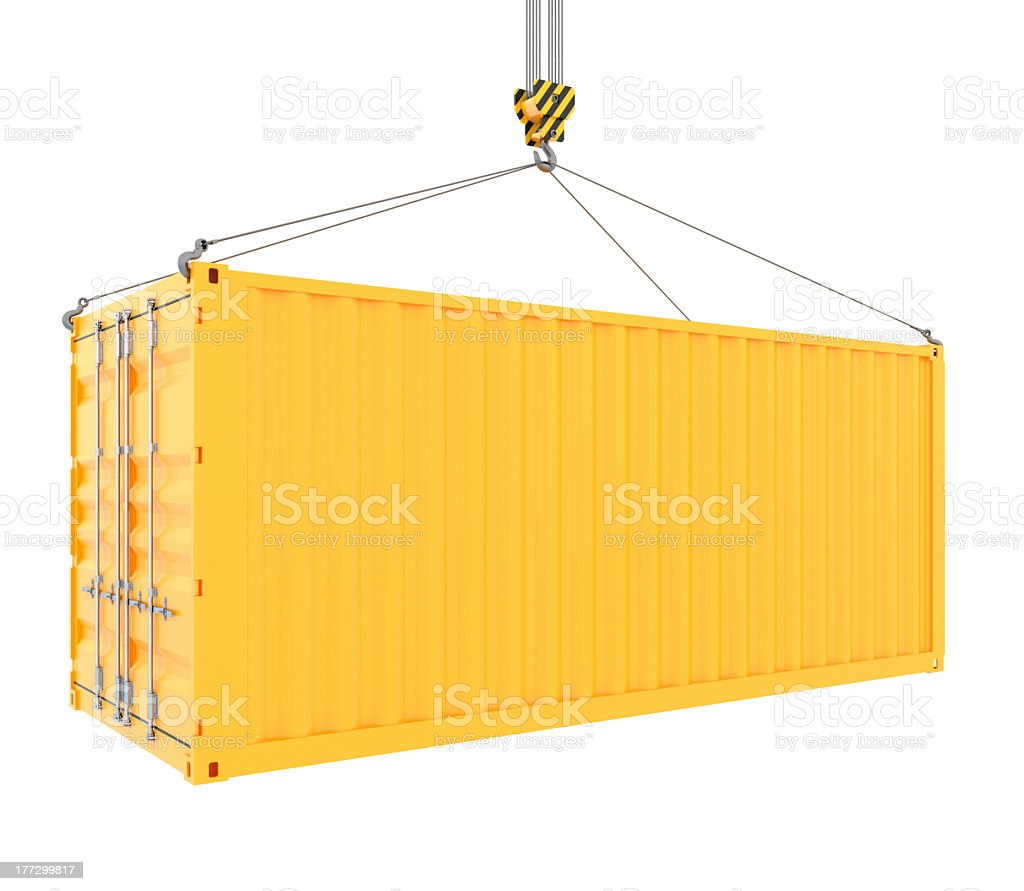 Yellow cargo container hanging from crane hook stock photo