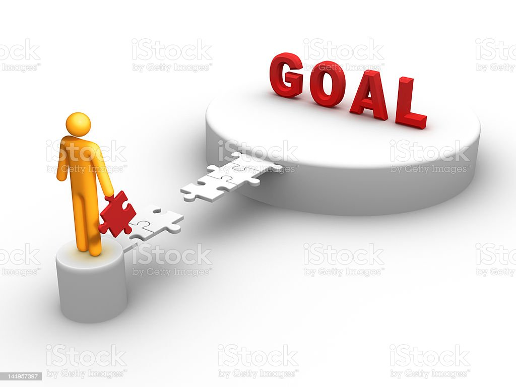 A yellow cartoon mans holding a piece to reach the word goal stock photo