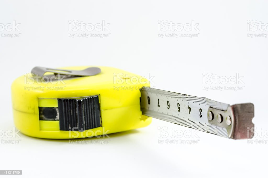 Yellow case measuring tape. Isolated in white stock photo