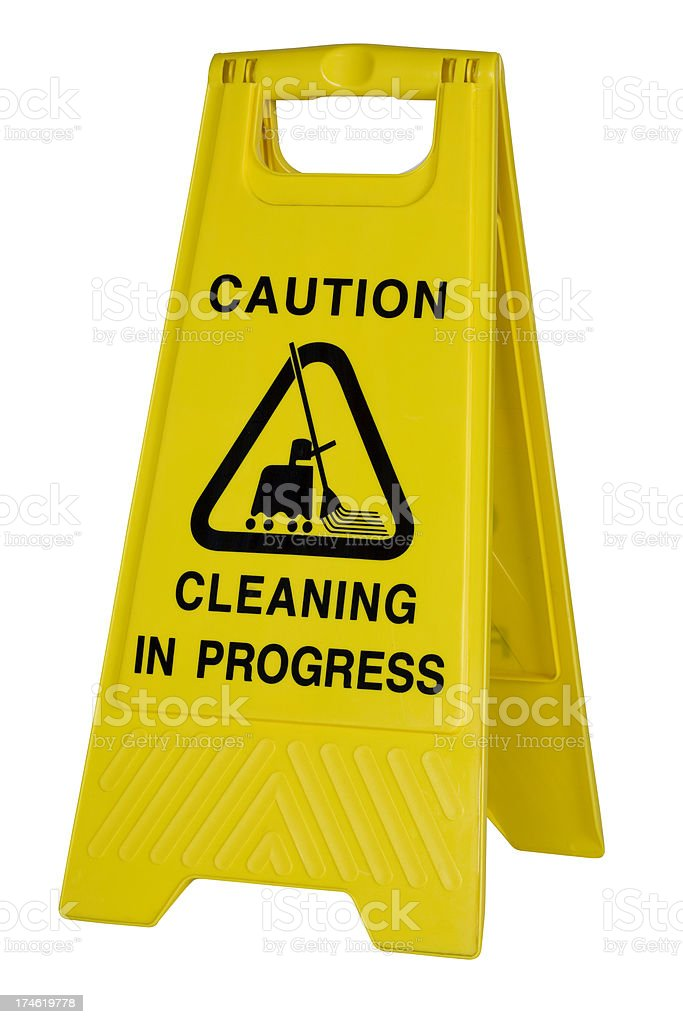 Yellow cation cleaning sign on white background royalty-free stock photo