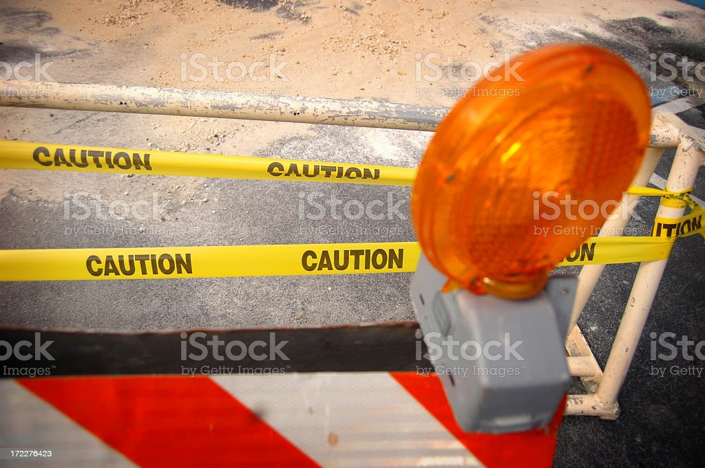 Yellow caution tape and Barricade stock photo