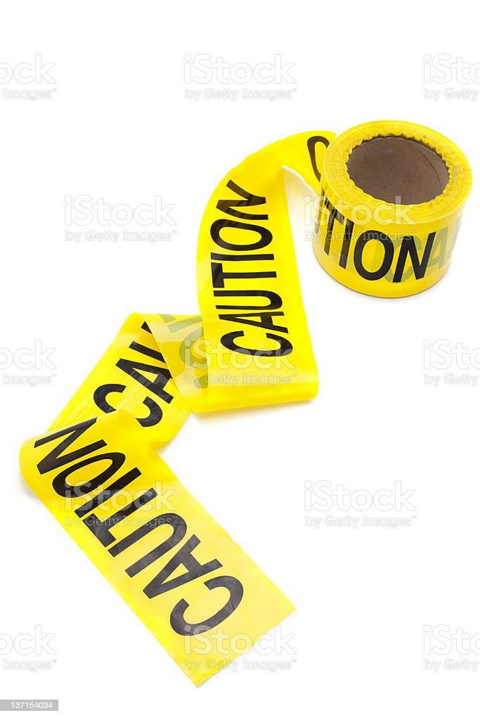 Yellow caution tape on white background stock photo