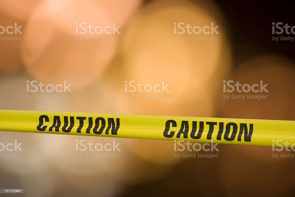 Yellow caution tape with blurry background stock photo