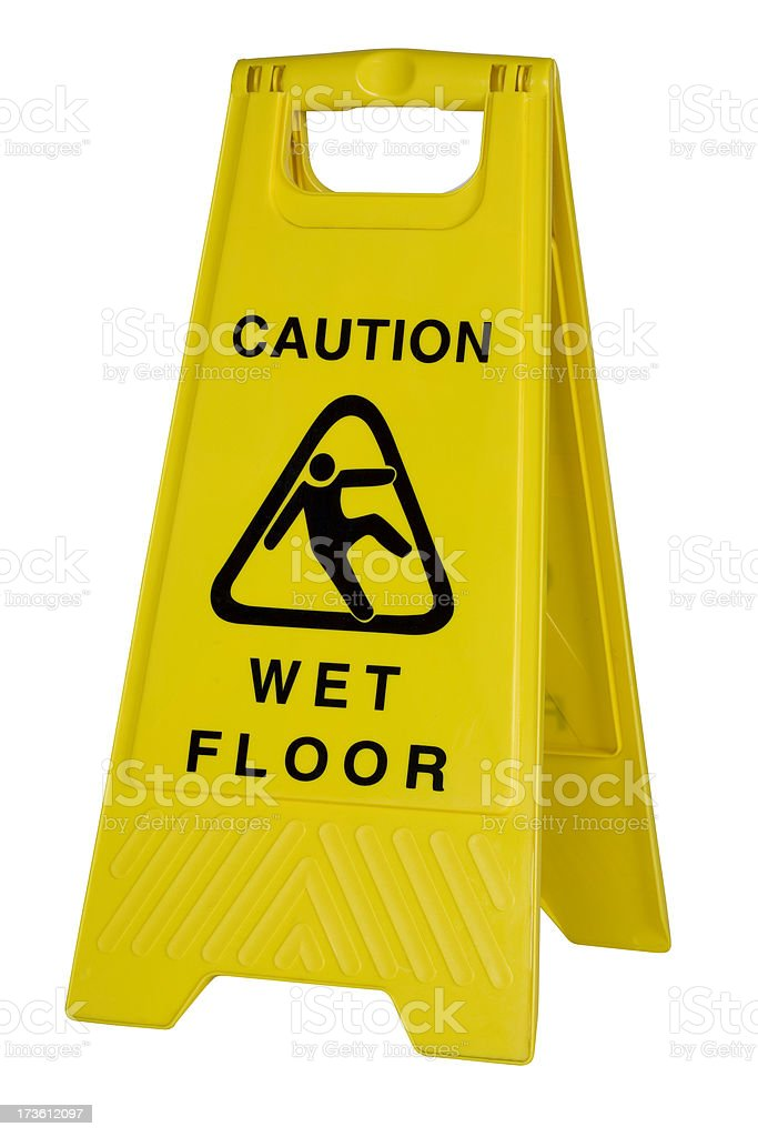 Yellow caution wet floor sign on white background stock photo