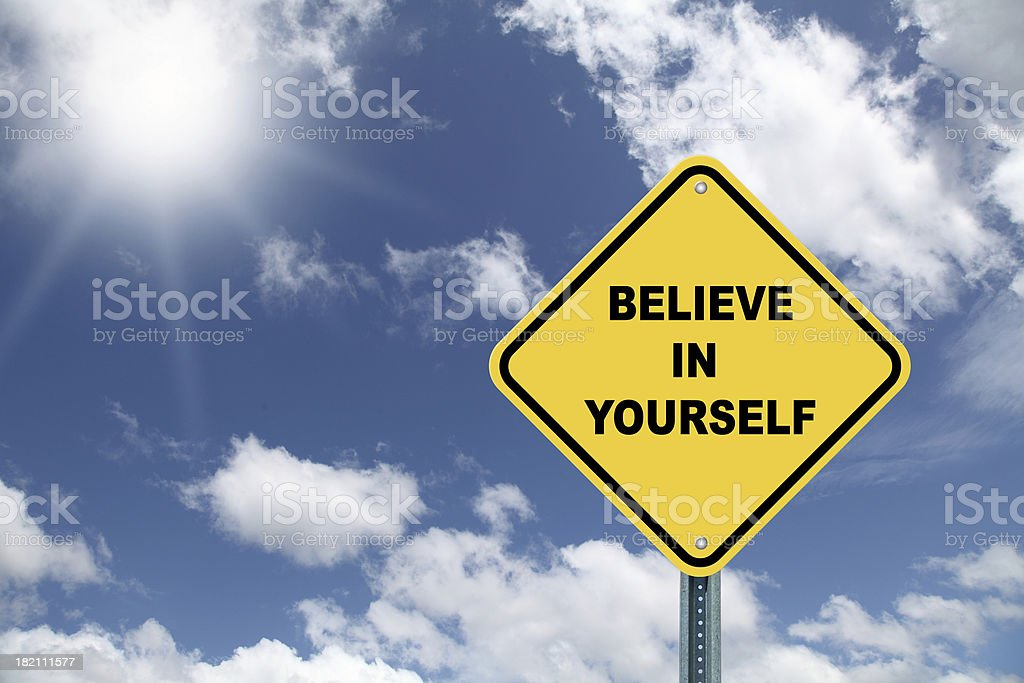 Yellow cautionary road sign Believe in yourself royalty-free stock photo
