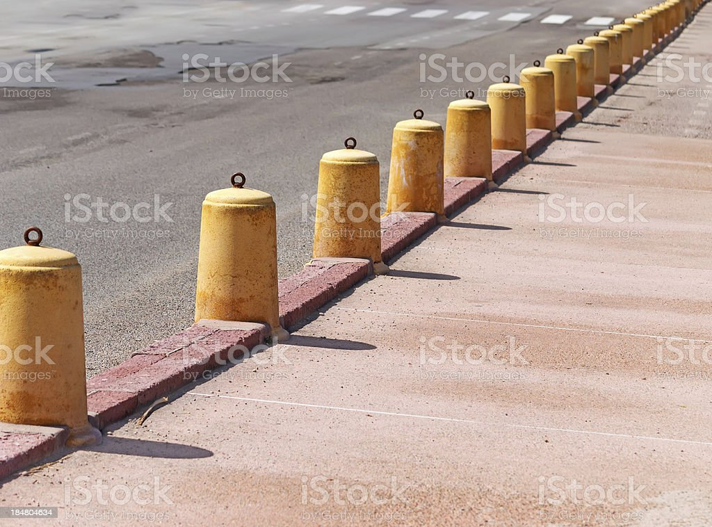 yellow cement pylons royalty-free stock photo