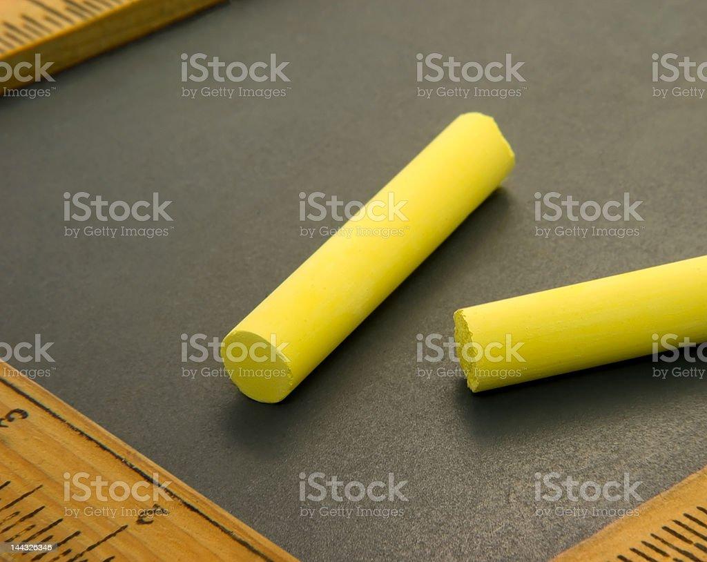 Yellow Chalk on Writing Slate royalty-free stock photo