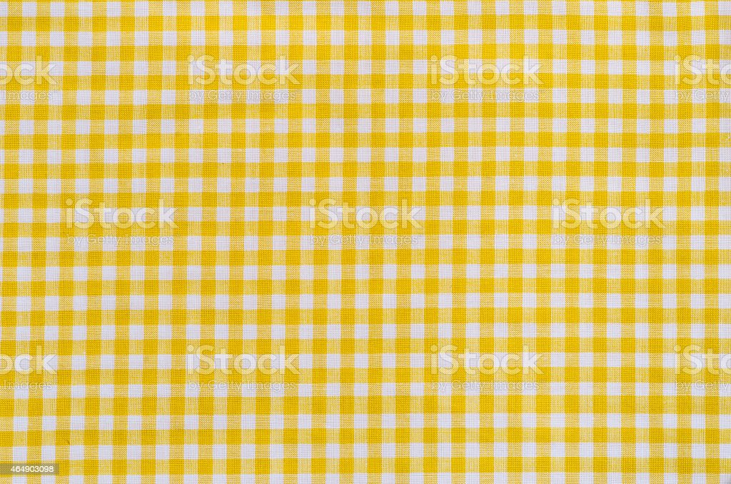 yellow checkered fabric tablecloth stock photo