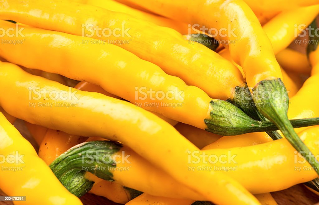 Yellow chili peppers closeup stock photo