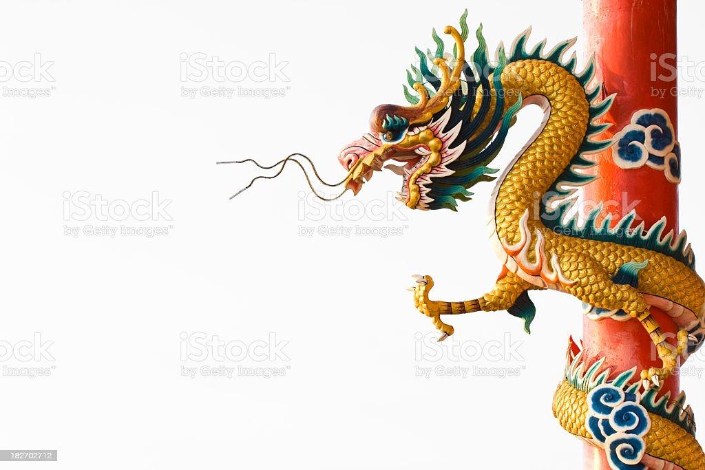 Yellow Chinese dragon on orange pole on white background stock photo
