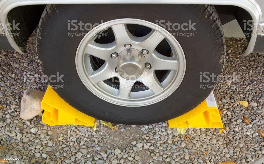 Yellow chock at the wheel stock photo