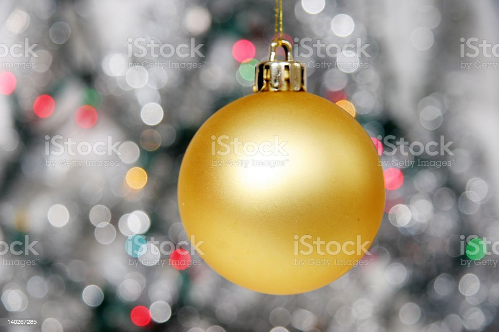 Yellow christmas ball against distant lights royalty-free stock photo