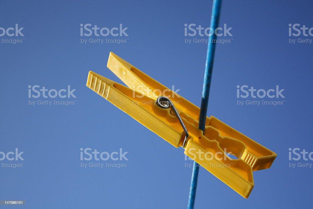 yellow clothes peg stock photo