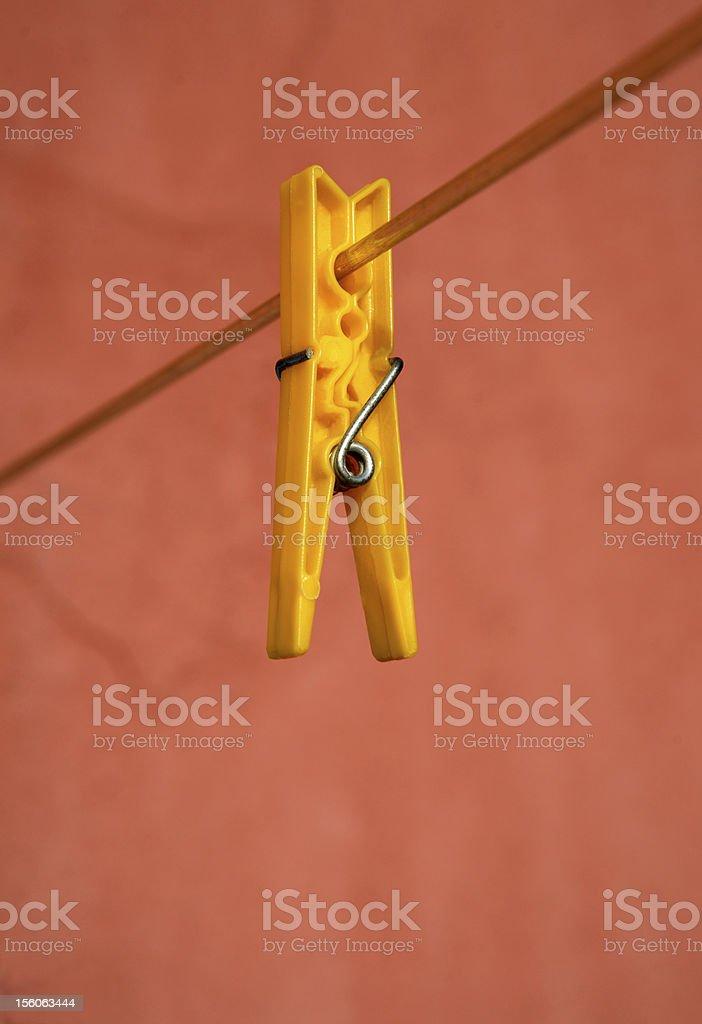 yellow clothes pin stock photo