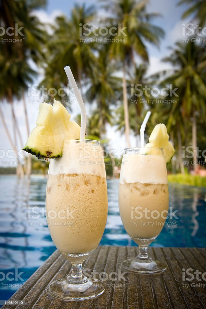 yellow cocktail stands on edge of pool royalty-free stock photo