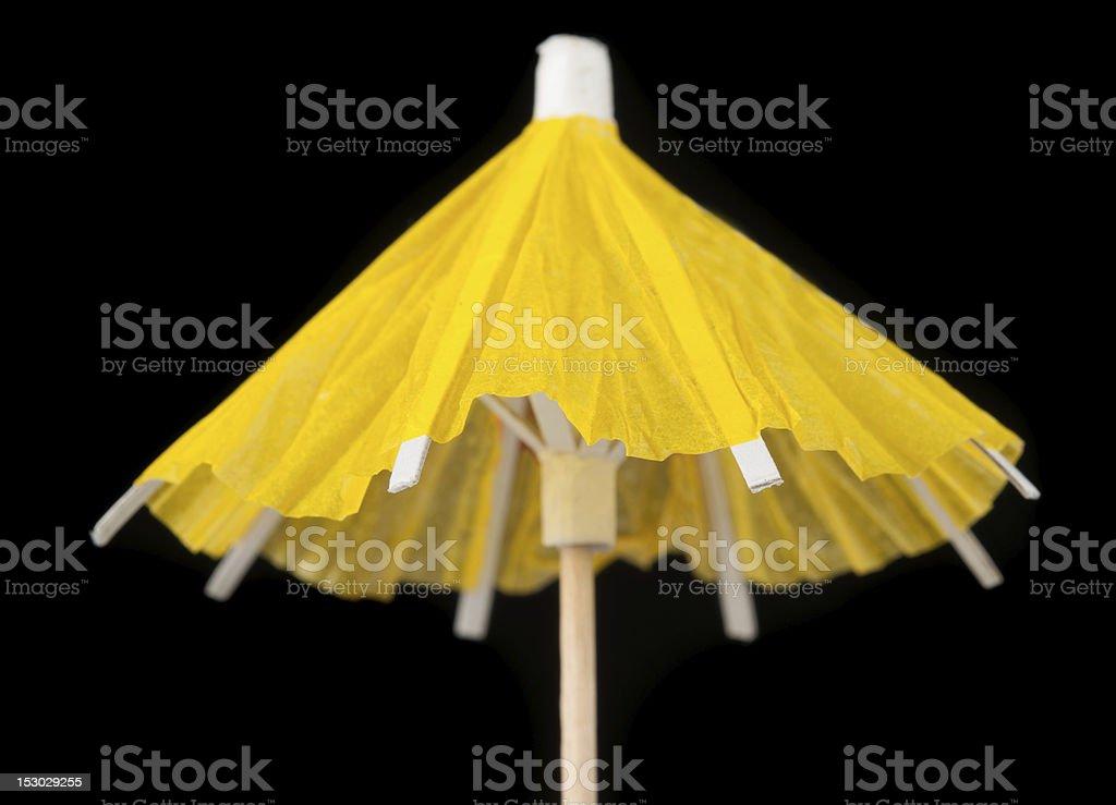 Yellow Cocktail Umbrella on Black Background stock photo