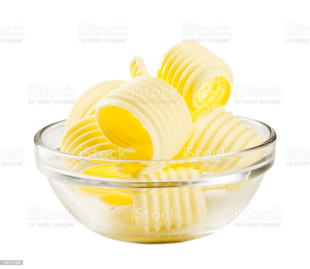 Yellow color butter curls in a glass bowl royalty-free stock photo