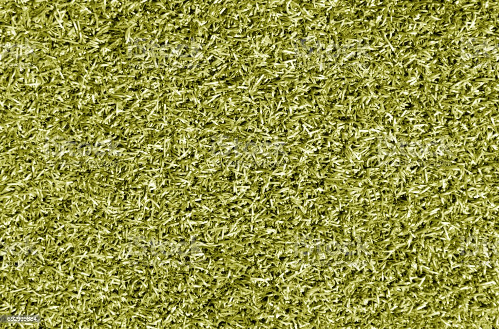 Yellow color decorative grass loan for sport and leisure. stock photo