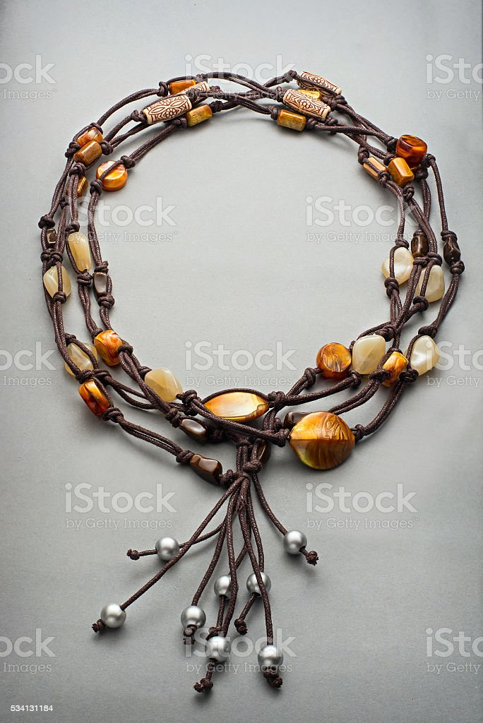 Yellow colored beads and leather string bracelet stock photo
