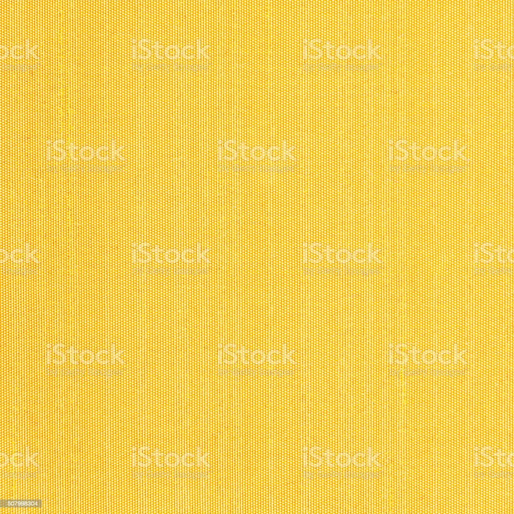 Yellow colored fabric-textured background stock photo