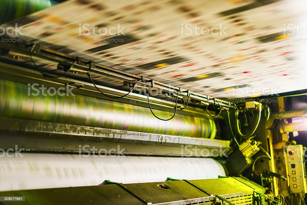 yellow colour cylinder in cmyk web offset printing press stock photo