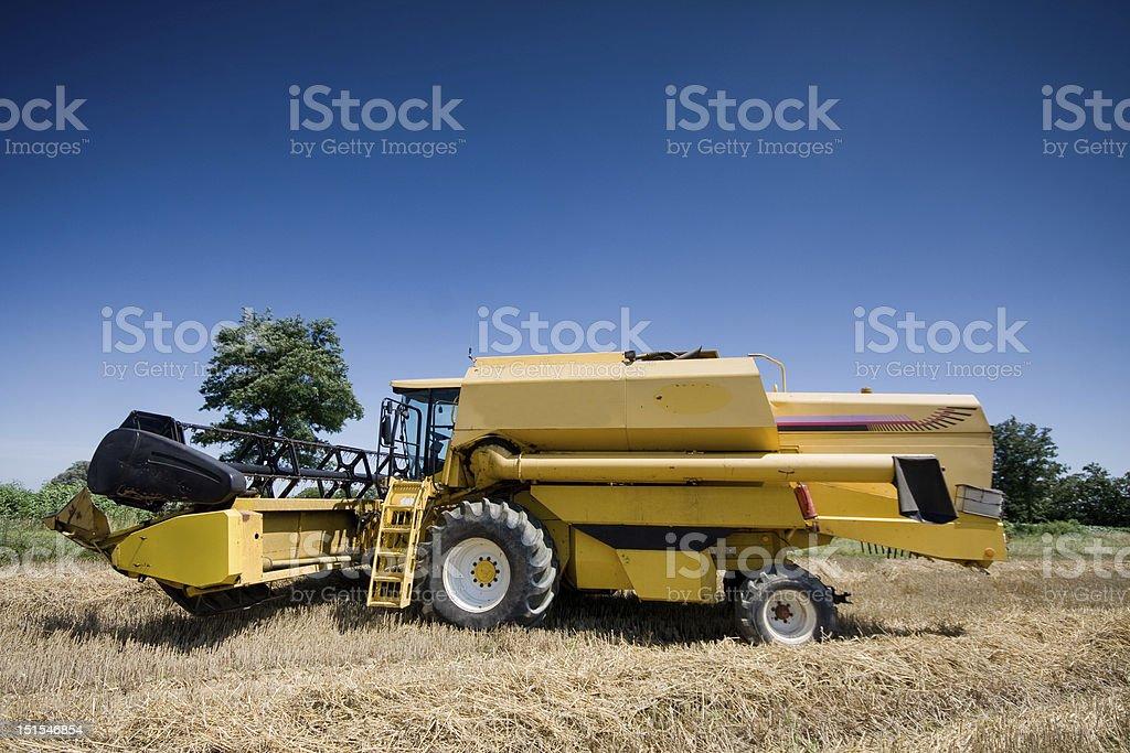 yellow combine royalty-free stock photo