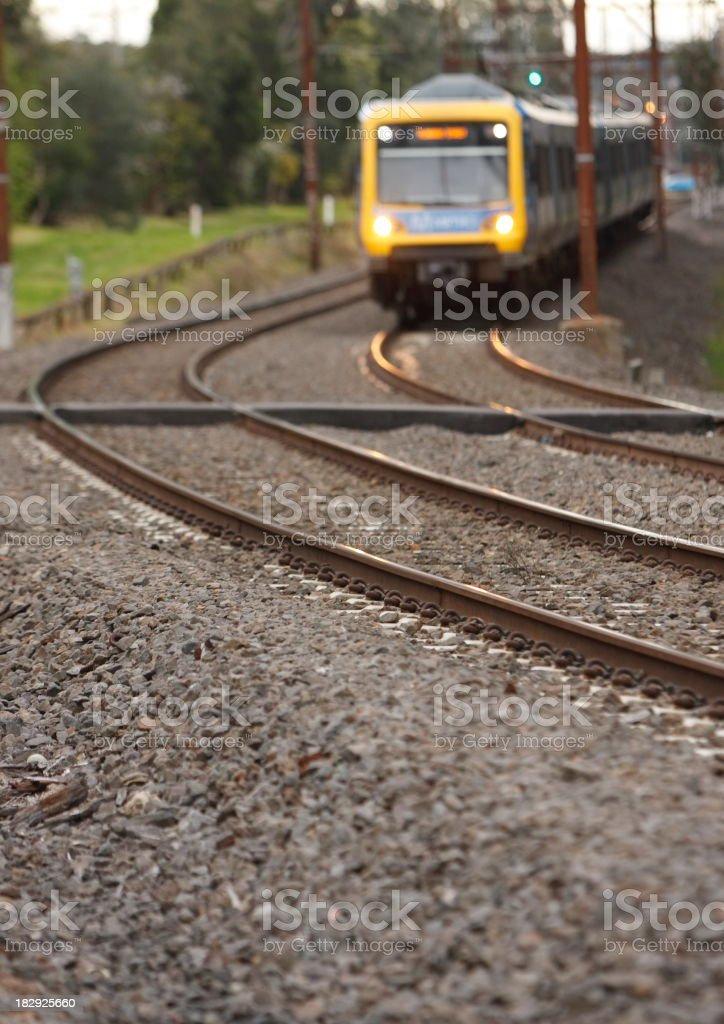 Yellow commuter train on a train track royalty-free stock photo