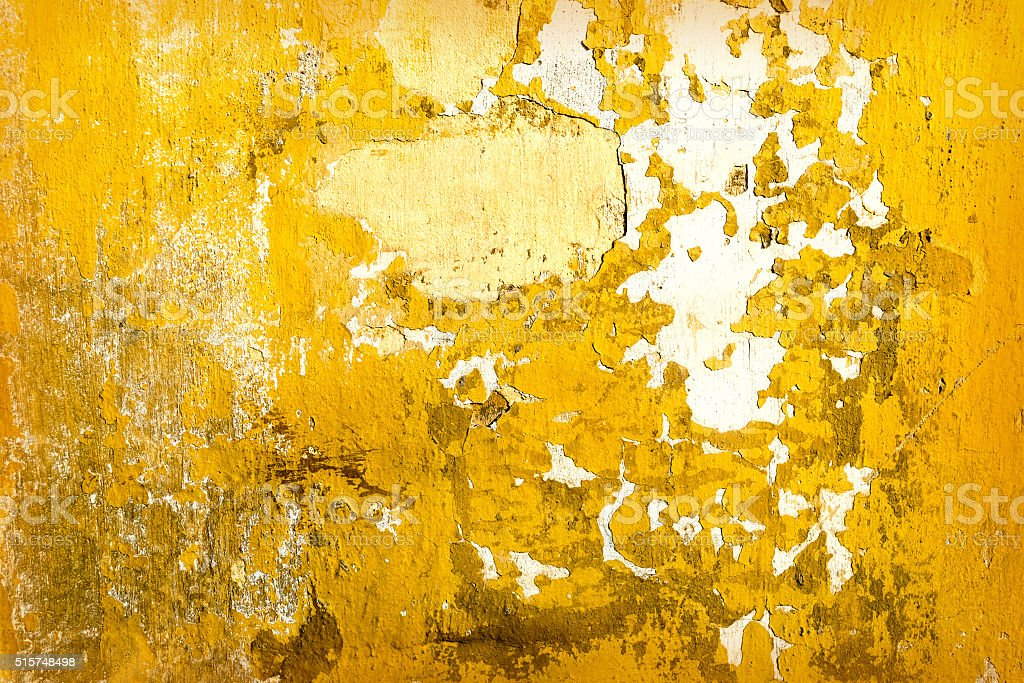 Yellow concrete cracked wall texture stock photo