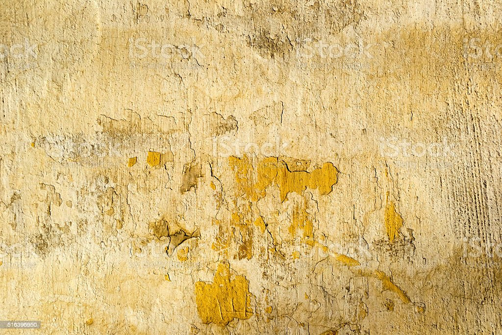 Yellow concrete cracked wall texture stock photo