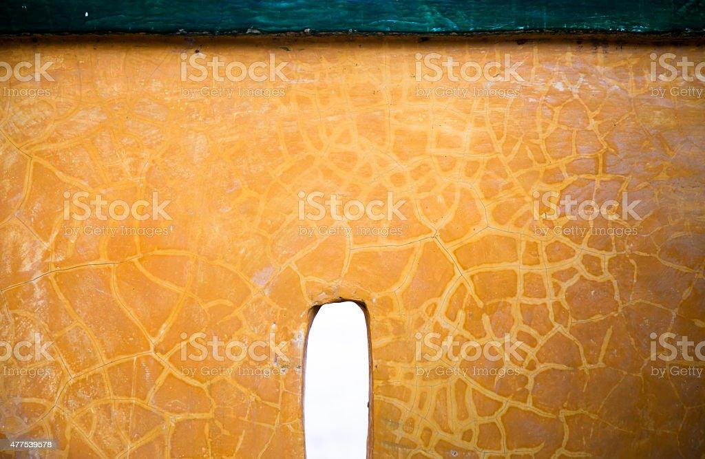 Yellow concrete wall background texture stock photo